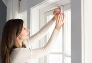 abode Security System Review - Shot of lady installing abode