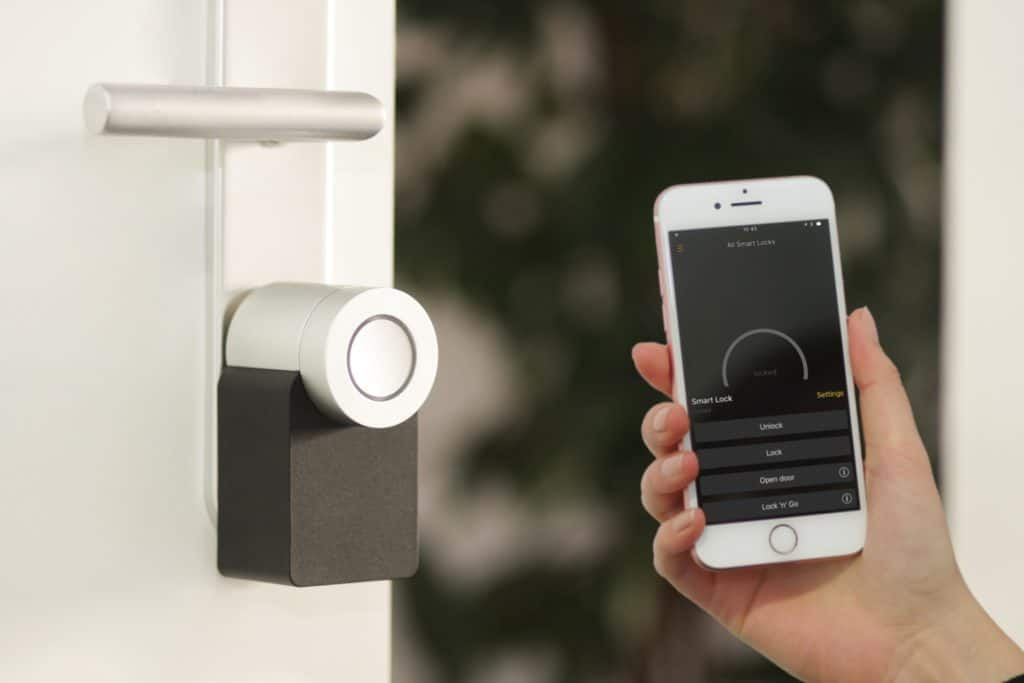 Smart Phone with Smart Lock on a door.