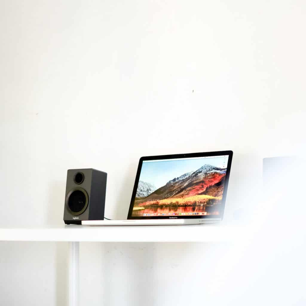 Desktop with computer and speaker stand