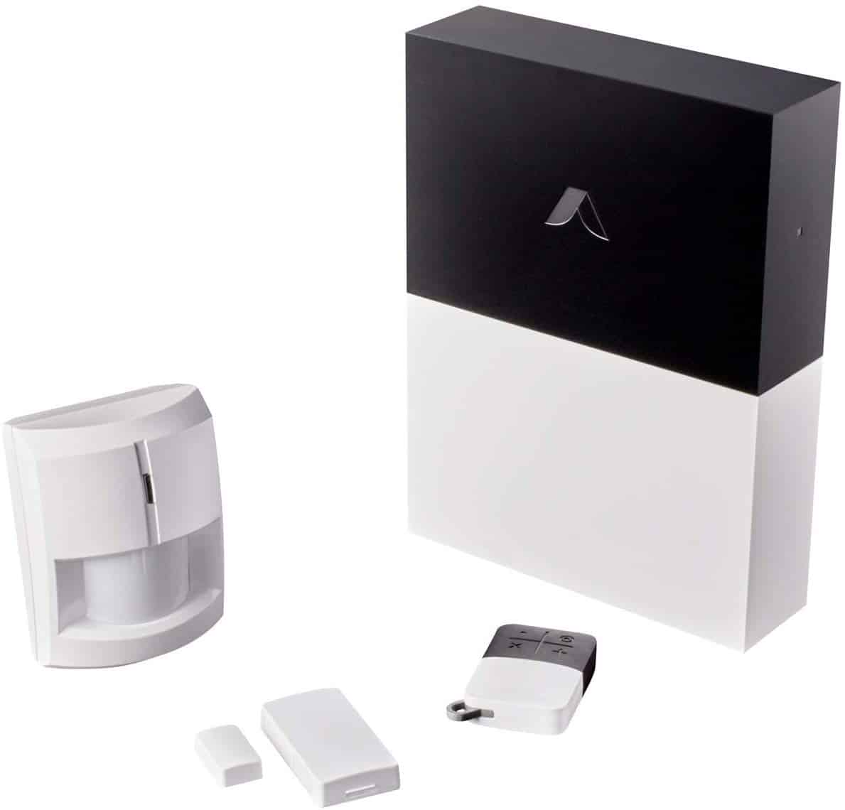 Picture of the abode z-wave security system on table with accessories