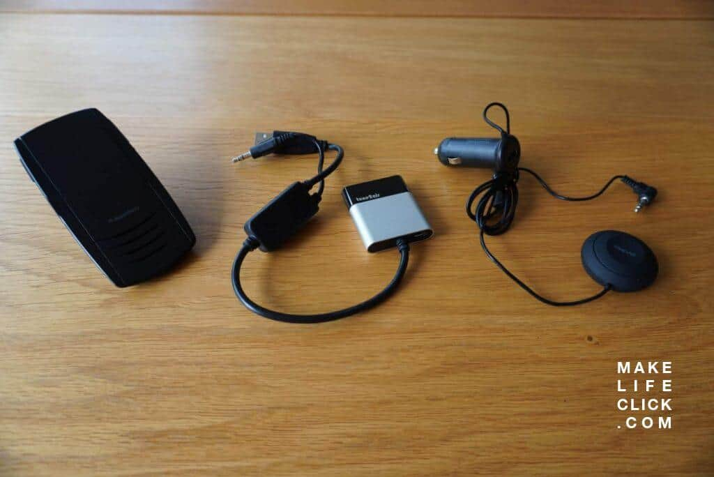 A selection of Bluetooth Car adaptors on a table next to each other.