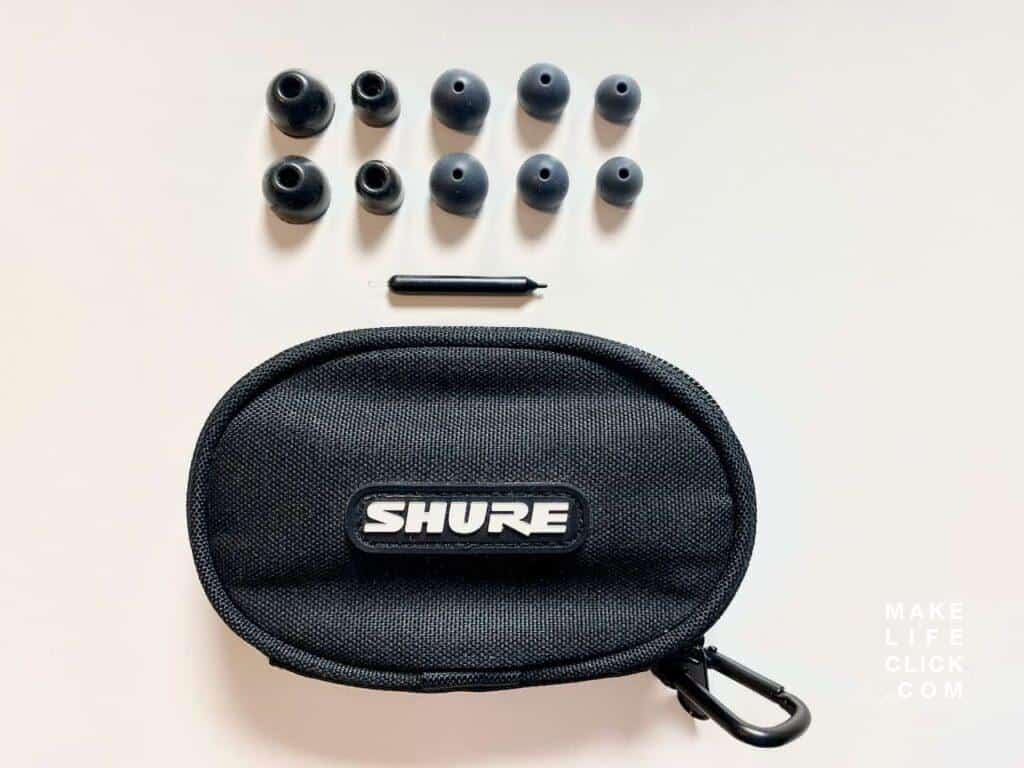 Shure SE-215 IEM with Case and ear tips on table