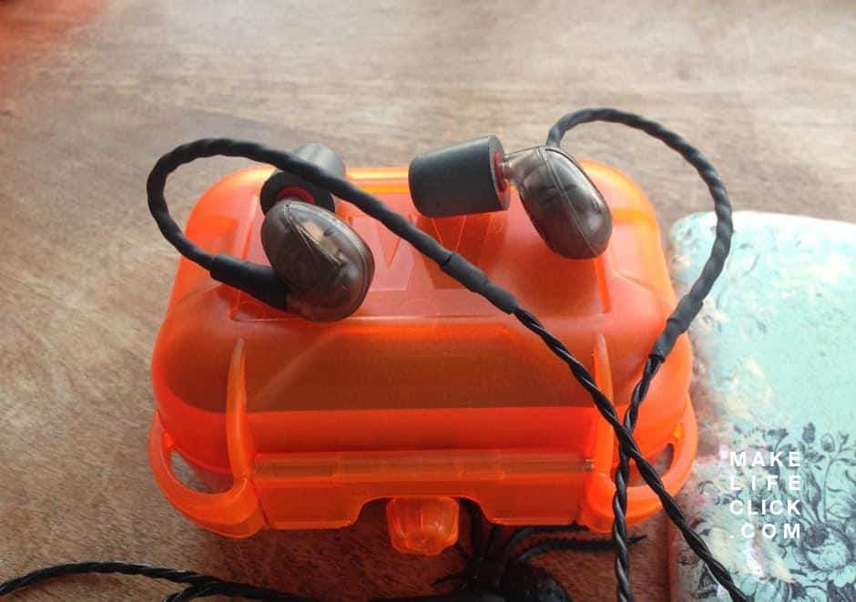 Westone UM Pro  in-ear monitors on table with IEM hard case.