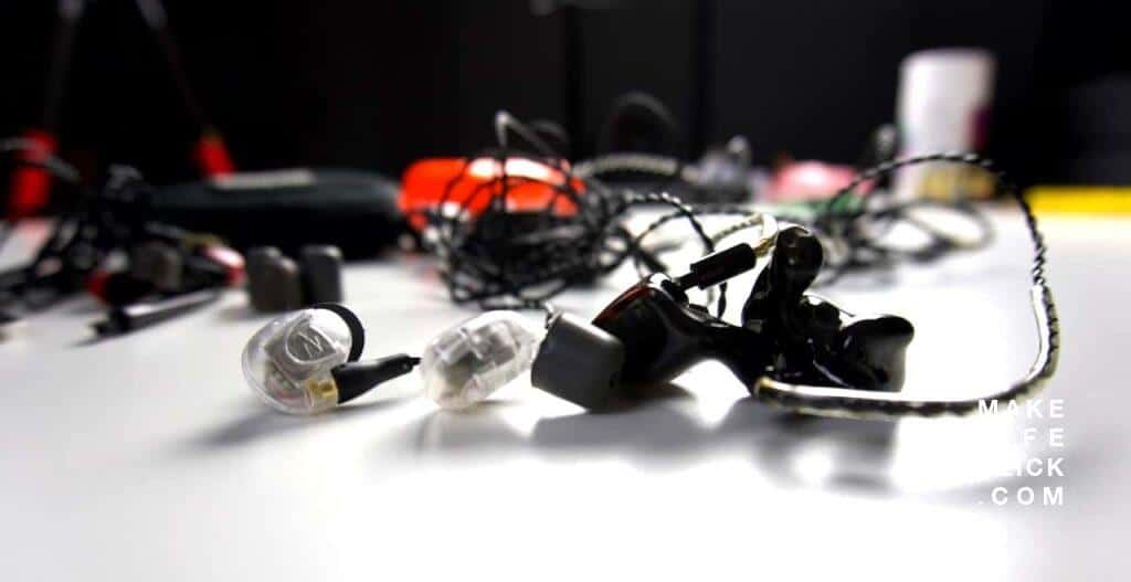 custom in-ear monitor and a universal iem sitting next to each other on a table