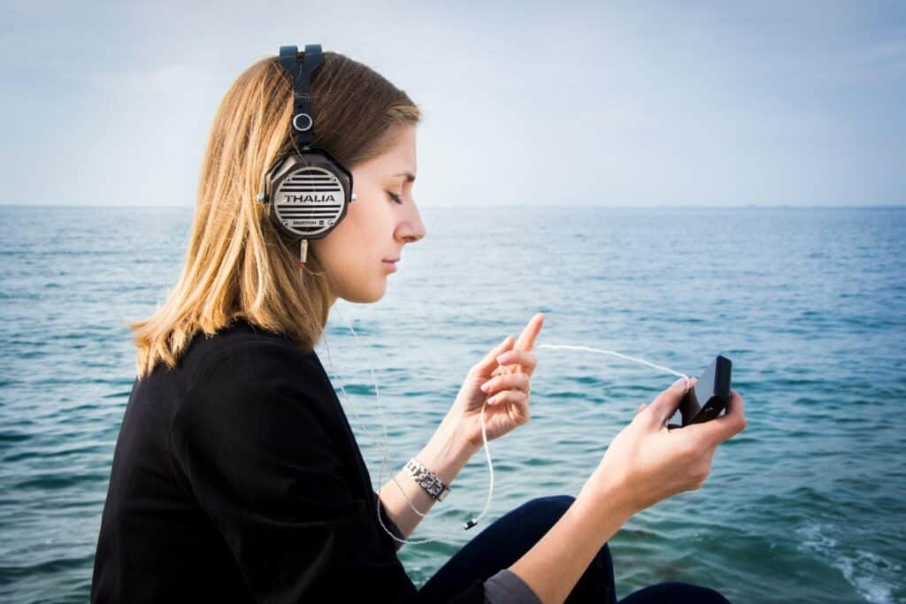 Listing to a pair of the best headphones for Audio Books on a boat