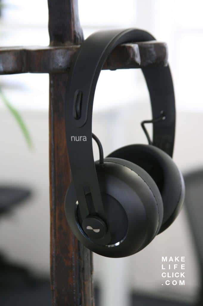 Nura headphones on stand
