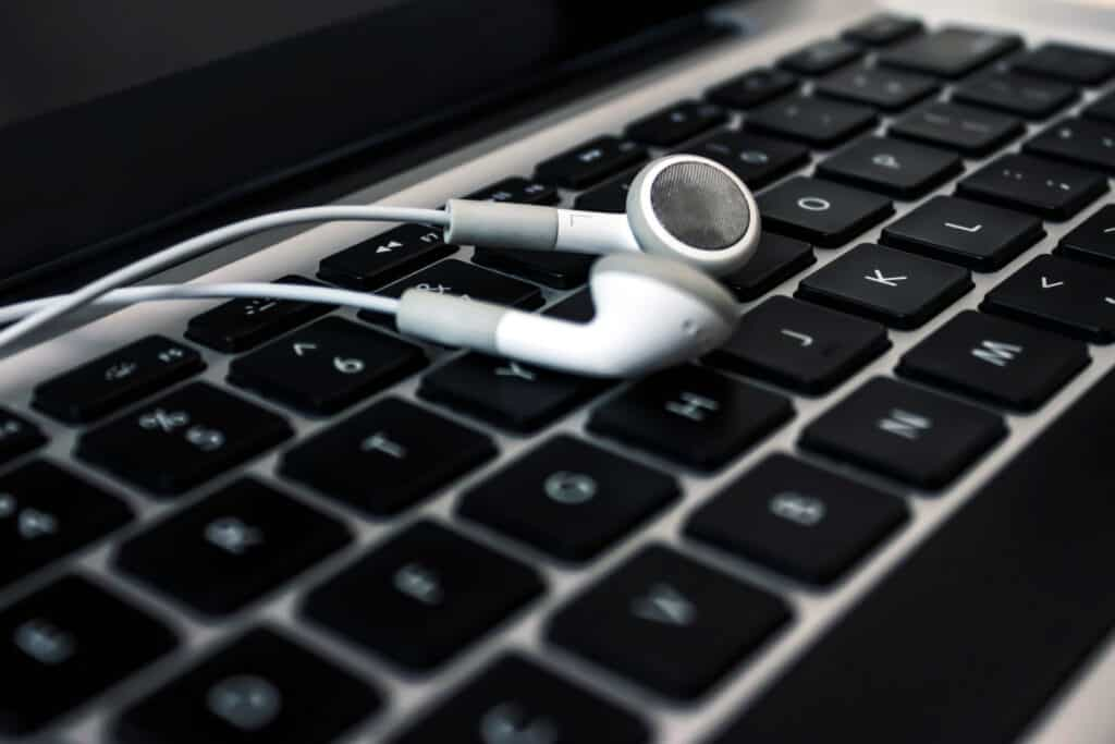 cheap earbuds on laptop keyboard