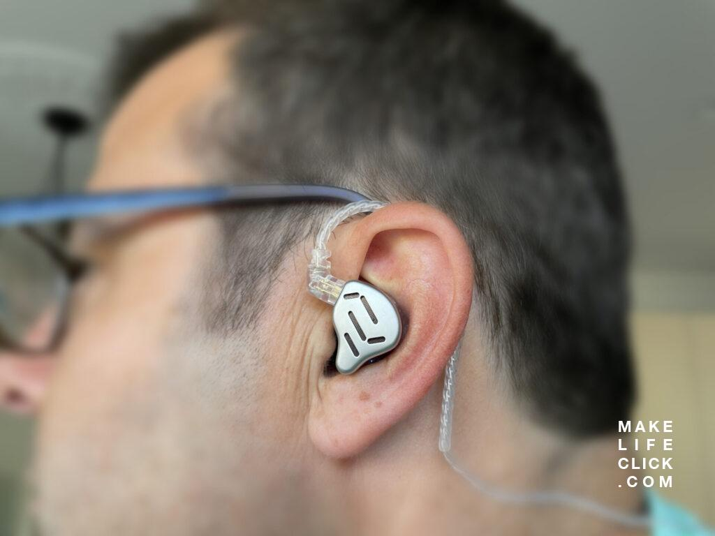 View of the KZ Zax fit inside a person's ear from the side view.