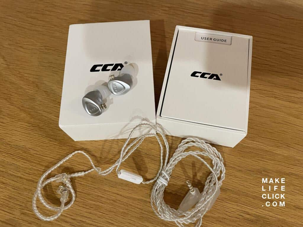 CCA CKX earphones with retail box and IEM cable on a table