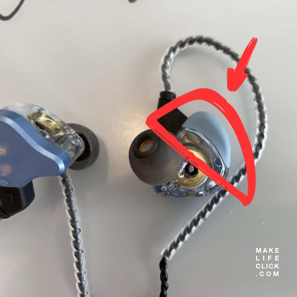 Up close photo of one of the earbuds with a red circle highlighting the special rubber fin build onto the earbud for better fit and comfort