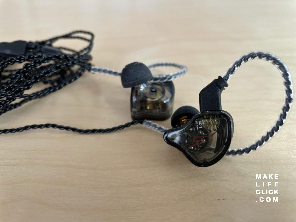 CCZ Melody IEMs on table with both in-ear monitors showing
